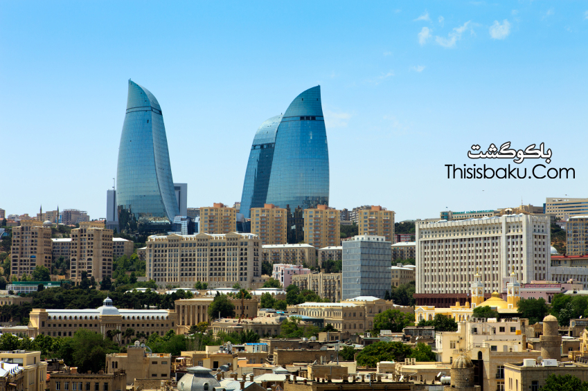 Baku, Azerbaijan - June.06.2012: City and the Flame Towers appearance from maiden tower in June.06.2012 Old and new city buildings can be seen during day. Also new modern buildings Flame towers are on the backside. Flame towers are biggest and modern residential, hotel and business complex in Baku, Azerbaijan.